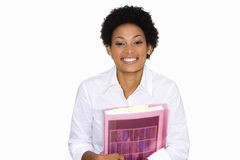 Young businesswoman with folder, smiling, portrait, cut out Stock Photo