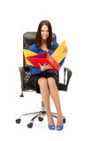 Young businesswoman with folders sitting in chair Stock Images