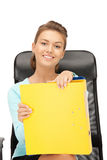 Young businesswoman with folders sitting in chair Stock Image