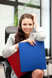 Young businesswoman with folders sitting in chair Royalty Free Stock Photos