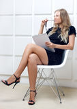 Young businesswoman with folders Stock Photo