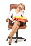 Young businesswoman with folders sitting in chair Royalty Free Stock Images