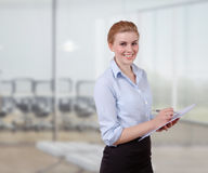 Young Businesswoman with Folio. In her office Royalty Free Stock Photos