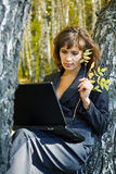 Young businesswoman in the forest. Royalty Free Stock Photography