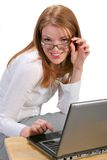 Young Businesswoman in front of a Computer Stock Image