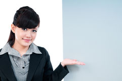 Young Businesswoman Gesturing At Blank Billboard Royalty Free Stock Photography
