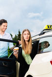 Young businesswoman getting out of taxi Royalty Free Stock Photos