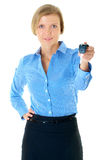 Young businesswoman gives car keys, isolated Royalty Free Stock Image