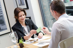 Young businesswoman giving a business card Stock Photo