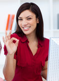 Young businesswoman giving the OK sign Stock Photo