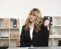 Young businesswoman giving a thumbs down Stock Photography