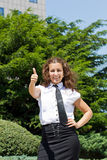 Young businesswoman giving a thumbs up Royalty Free Stock Photo