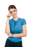 Young businesswoman with glasses. And clock Royalty Free Stock Images