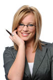 Young Businesswoman with glasses. Holding a pen Stock Images