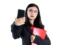 Young businesswoman in glasses cell  red folder and pen female, person, success. Portrait of a young businesswoman in glasses with a red folder  pen female Royalty Free Stock Photography