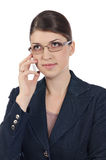 Young businesswoman with glasses and cellphone. Young businesswoman with glasses and white cellphone Royalty Free Stock Photos