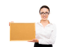 Young businesswoman in glasses holding a frame Royalty Free Stock Images