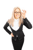 Young businesswoman with glasses looking at camera Stock Images