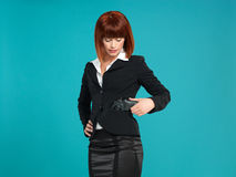 Young businesswoman, with gun in pocket Stock Image