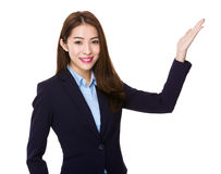 Young businesswoman with hand showing blank sign for product sel. Ling isolated on white background Royalty Free Stock Photos