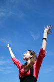 Young businesswoman with hands up Stock Photo