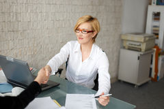 Young businesswoman handshake with client in office Stock Images
