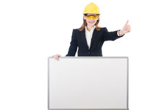 Young businesswoman with hard hat Royalty Free Stock Photos