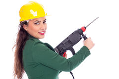 Young businesswoman with hard hat holding a drill Royalty Free Stock Photography