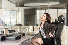 Young businesswoman having back pain Stock Images