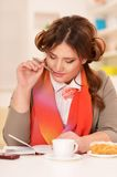 Young businesswoman having breakfast Royalty Free Stock Photography