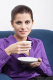 Young businesswoman having coffee break. Pretty young businesswoman having a coffee break in the office Royalty Free Stock Image