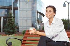 Young businesswoman having a coffee break Stock Photo
