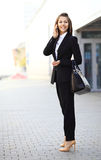 Young businesswoman having a conversation using a smartphone Royalty Free Stock Photos