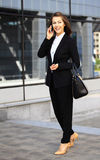 Young businesswoman having a conversation using a smartphone Stock Photos