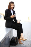 Young businesswoman having a conversation using a smartphone Royalty Free Stock Photo