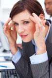 Young businesswoman having a headache Stock Image