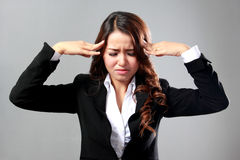Young businesswoman having headache, stress, problem Royalty Free Stock Images
