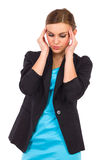 Young businesswoman having headache. Royalty Free Stock Image