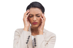 Young businesswoman having a headache Royalty Free Stock Images