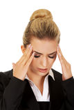 Young businesswoman having huge headache Stock Image