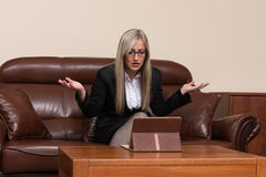 Young Businesswoman Having Stress In The Office Royalty Free Stock Photos