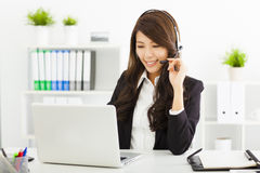 Young businesswoman in headset Stock Images