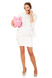 Young businesswoman in headset holding piggybank.  Royalty Free Stock Photos