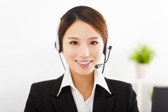 Young businesswoman with headset in office Stock Photo