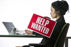 Young businesswoman with a Help Wanted sign Royalty Free Stock Photo