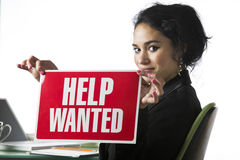 Young businesswoman with a Help Wanted sign Stock Image