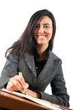 Young businesswoman at her desk Stock Images