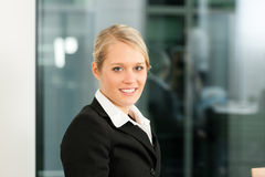 Young businesswoman in her office Royalty Free Stock Photography