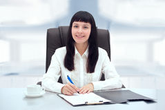 Young businesswoman at her office. Stock Photo