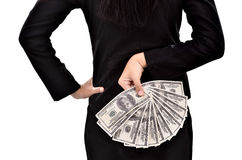 Young businesswoman hides a lot of dollars in hands Royalty Free Stock Photo